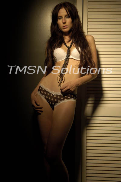 Long brown hair down over shoulders leaning against the wall in black polka-dotted panties and white bra only