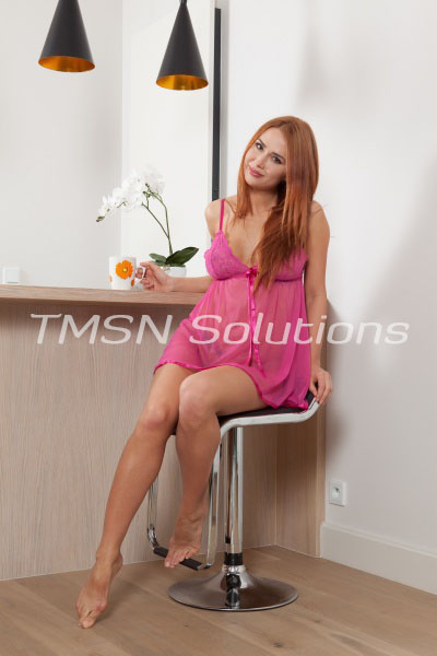 Darling Red Head Wearing Pink Lingerie Sitting On Chair