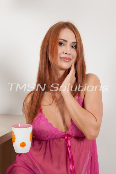 Sexy Red Head Wearing Pink Lingerie Teddy Holding Floral Coffee Cup Thinking Freaky Thoughts
